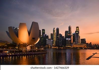 Singapore, Singapore - June 22, 2015: Singapore business district skyline during sunset
