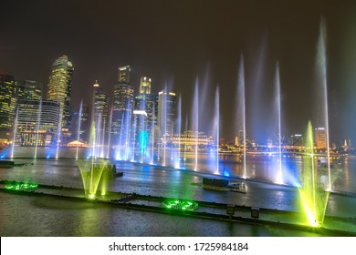 SINGAPORE - JUNE 23, 2018: Fountains night laser show in Singapore near Marina Bay Sands hotel at summer night