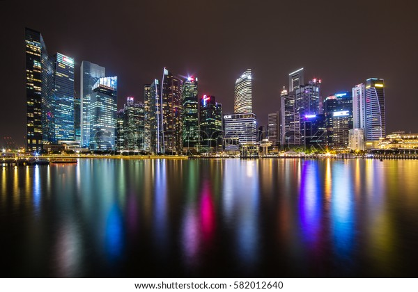 Singapore - June 24, 2016: Singapore skyline and illuminated financial district night view