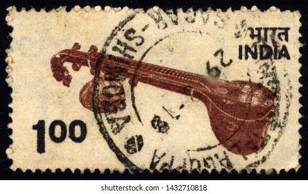 SINGAPORE - JUNE 24, 2019: A stamp printed in India shows sitar, circa 1970