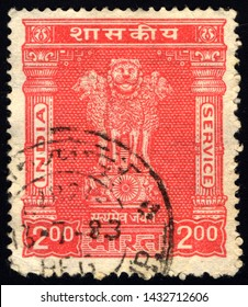 SINGAPORE - JUNE 24, 2019: A stamp printed in India shows four Indian lions capital of Ashoka Pillar, without inscription, from the series Ashoka Pillar, circa 1957
