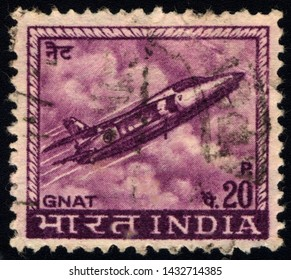 """SINGAPORE - JUNE 24, 2019: A stamp printed in India shows a Gnat fighter jet from the Indian Air force, with the inscription """"Gnat"""", from the series """"Definitive stamps"""", circa 1967."""