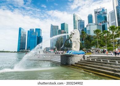 Singapore  - June 25, 2014: The Merlion fountain and Marina Bay in Singapore. Merlion is a mythical creature with the head of a lion and the body of a fish,and is a symbol of Singapore.