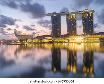 Singapore, Singapore - June 28, 2017:  night  of Singapore`s skyline in the early morning using long time exposure, sunrise with colorful sky.