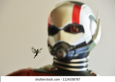 Singapore - June 29, 2018: Small Wasp Image Behind A Human Size Model Ant Man at The Standee of A Marvel Superhero Movie Ant-Man 2 and the Wasp displays at the theater
