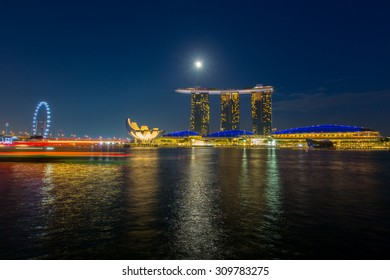 SINGAPORE - JUNE  30 : Marina Bay Sands hotel light show at night on JUNE 30, 2015 in Singapore. It is the world's most expensive building with cost of US$ 4.7 billion and landmark of Singapore.