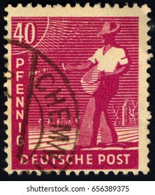 SINGAPORE – JUNE 9, 2017: A stamp printed in Germany shows sower, circa 1948