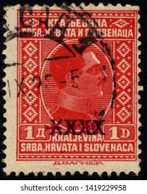 SINGAPORE - JUNE 9, 2019: A stamp printed in Yugoslavia (Kingdom Serbia, Croatia and Slavonia) shows portrait of King Alexander I of Yugoslavia, circa 1924