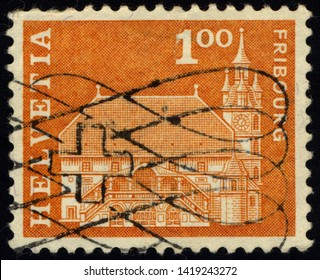 SINGAPORE - JUNE 9, 2019: A stamp printed in Switzerland shows Townhall, Freiburg, Postal history motives and monuments serie, circa 1967