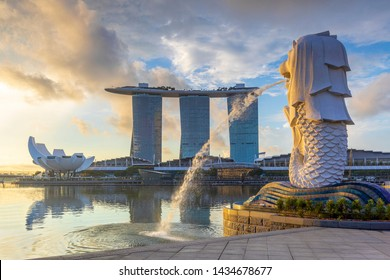 singapore, singapore - June 9, 2019: sunrise at the marina in singapore with the iconic building, merlion