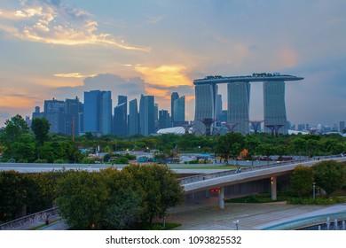Singapore landmark city skyline at the Marina bay during sunset dusk.