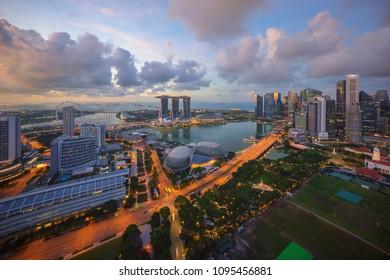Singapore landmark city skyline at the Marina bay during sunrise.