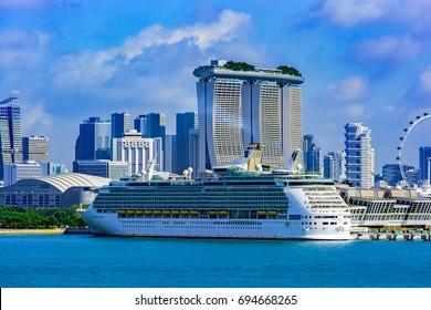 SINGAPORE, MALAYSIA - Jan 06, 2017: Voyager-class cruise passenger ship 'Mariner of the Seas' from Royal Caribbean International berthed at Marina Bay Cruise Centre in Singapore.