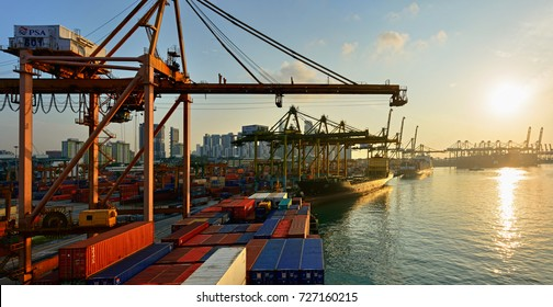 SINGAPORE, MALAYSIA - Mar 10, 2017: Sunset panorama of Port of Singapore container cargo terminal, run by PSA, one of the busiest shipping terminals in the world. Keppel Harbour, Singapore, Malaysia.