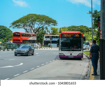 Singapore - Mar 12, 2016. Buses run on street in Singapore. Singapore economy has been ranked as the most open in the world.