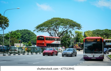 Singapore - Mar 12, 2016. Vehicles run on street in Clark Quay, Singapore. Singapore is a global financial center with a tropical climate and multicultural population.