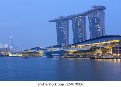 Singapore - MAR 20 : Nightscape of Singapore Marina Bay Sand and Helix Bridge on March 20,2015 in Singapore. Marina Bay Sands is billed as the world's most expensive casino property at S$8 billion.