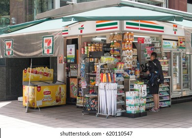 SINGAPORE - MAR 21, 2017 : Tourist buy food and drink in convenience store at 7-Eleven shop in front of the street on Orchard Road, Singapore.