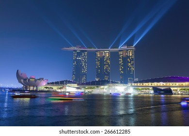 SINGAPORE - MAR 21 : Marina Bay Sands hotel light show at night on March 21,2015 in Singapore. It is the world's most expensive building with cost of US$ 4.7 billion and landmark of Singapore.