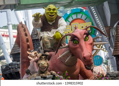 Singapore Mar 25th 2016: The Shrek and his friend, like donkey, dragon, pig , say hello to tourist in universal studios parade