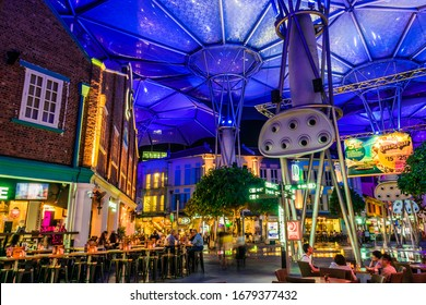 SINGAPORE - MAR 3, 2020: Clarke Quay after sunset, popular nightlife district of Singapore