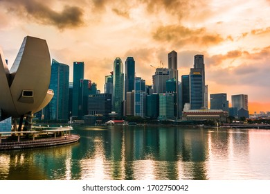 SINGAPORE - MAR 6, 2020: Singapore downtown waterfront with ArtScience Museum seen from Helix Bridge after sunset