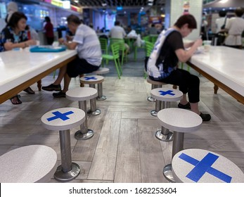 Singapore Mar2020 Social distancing rules in practice, alternate seating in local public food courts (restaurants, food outlets), to reduce risk of further transmission; safety measures