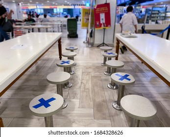 Singapore Mar2020 Social distancing rules in practice, alternate seating in local public food courts (kopitiams, restaurants, food outlets), to reduce risk of further transmission; safety measures