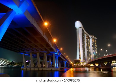 SINGAPORE - MARCH 06: Marina Bay Sands Resort at night on March 06, 2013 in Singapore. It is billed as the world's most expensive standalone casino property at S$8 billion