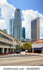 Singapore, Singapore - March 1, 2016: Boat Quay District and UOB Plaza of Downtown Core of Singapore skyline. United Overseas Bank is located in the Plaza