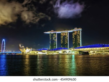 Singapore, Singapore - March 1, 2016: Singapore Flyer, Artscience museum and Marina Bay Sands Hotel and Casino of Downtown Core, Singapore at night. Cityscape of luxury resort with swimming pool