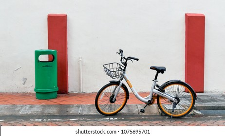 SINGAPORE - march 10: OBike bicycle sharing parking with green garbage on Pagoda street, Chinatown, Singapore, on March 10,2018.