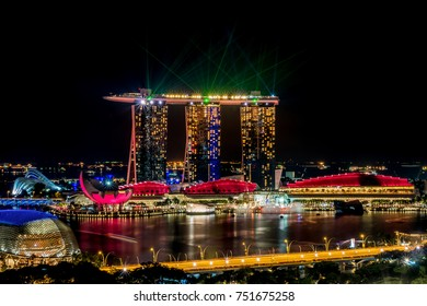 SINGAPORE - March 13 2016 : Beautiful laser show at Marina Bay Sands Hotel in night time is most popular for tourist and landmark center of Singapore city.