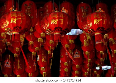Singapore - March 13 2019: Red Chinese hanging lanterns in Buddhist temple in Chinatown, Singapore
