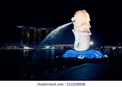 SINGAPORE MARCH 18, 2013 The Merlion fountain is a symbol of Singapore in the evening