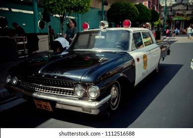 SINGAPORE MARCH 18, 2013 An old American patrol police car in an amusement park