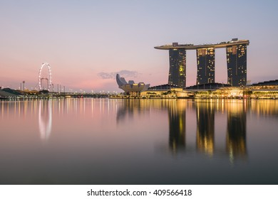 Singapore - March 19, 2016 :  Sunrise at Marina Bay on 19 March 2016.Marina Bay is a bay located in the Central Area of Singapore.