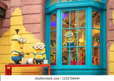 Singapore - March 2, 2018: Minion models with painting buckets decorated at front of Minion Mart, a shop sale souvenirs from Minion animation film at Universal Studio Singapore.