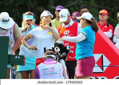 SINGAPORE - MARCH 2: Koreans Hee Kyung Seo and Inbee Park having a casual chat at hole 1 during HSBC Women's Champions at Sentosa Golf Club Serapong Course March 2, 2014 in Singapore