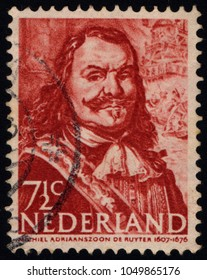 SINGAPORE - MARCH 20, 2018:A stamp printed in the Netherlands shows a portrait of the Dutch admiral Michiel Adriaenszoon de Ruyter (1607-1676), circa 1943