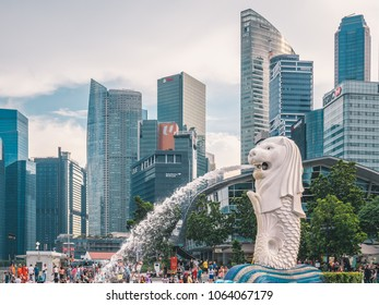 Singapore - MARCH, 2018: The main symbol of Singapore - Merlion line with skyscrapers and cityscape on background.