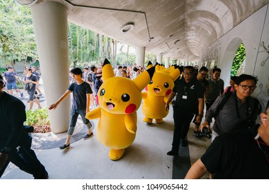 Singapore, March 2018: The Pikachu parade at Gardens by the Bay, a major tourist and local attraction in Singapore. Crowds gather to watch and take photos of many Pikachus (Pokemon) march and dance.
