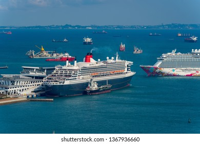 Singapore - March 2019: Queen Mary 2 at Singapore port. RMS Queen Mary 2 is the flagship of Cunard Line.