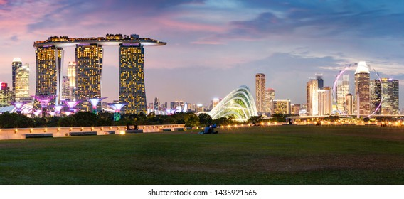 SINGAPORE, SINGAPORE - MARCH 2019: Vibrant Singapore skyline with Marina Bay Sands, Gardens by the bay with cloud forest, flower dome and supertrees at sunset. Top view from marina barrage