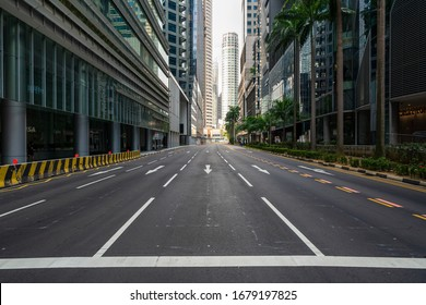 Singapore - March 2020: Quiet Singapore street with less tourists and cars during the pandemic of Coronavirus disease (COVID-19).