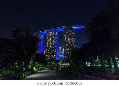 SINGAPORE - MARCH 22, 2017: From the Gardens by the bay, night shoot of of Marina Bay Sands Hotel Landmark of Singapore.