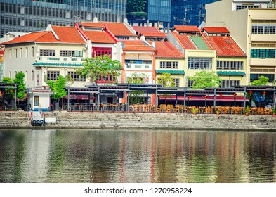 Singapore - March 24, 2018: A close-up view at pubs and restaurants along the riverside on Boat Quay.