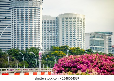 Singapore - March 24, 2018: A view from the sidewalk of Esplanade bridge from left to right. The towers of Raffles City, Swissotel Stamford are at the background.
