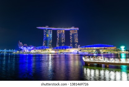 SINGAPORE - MARCH 24, 2019: Spectra - A Light and Water Show at Marina Bay Sands and the event Plaza is a free daily 15 minute show.