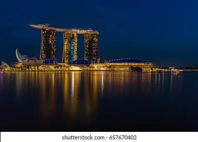 Singapore - March 25, 2017: Night scene of Marina Bay and Marina Bay Sands Hotel with illuminated lighting